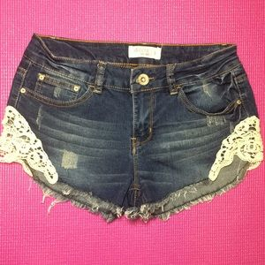 Ardene embroidered distressed jean shorts